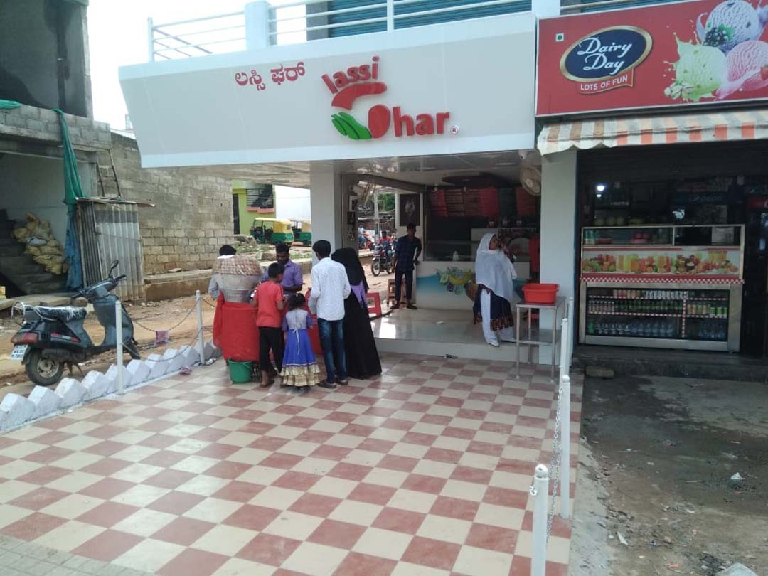 lassighar Shop with customers enjoying the Deserts